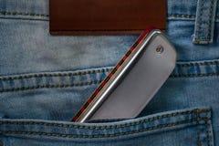 Arm?nica de los azules en el bolsillo de la mezclilla foto de archivo libre de regalías