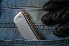 Arm?nica de los azules en el bolsillo de la mezclilla fotos de archivo