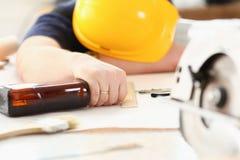 Free Arm Of Drunken Worker In Yellow Helmet Stock Image - 104682251