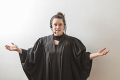 Arm open to the lord. Thirty something brunette woman dress as a preacher with her arm opened Stock Photography