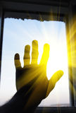 Arm in open window Royalty Free Stock Image