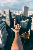 Arm outstretched over city Royalty Free Stock Images