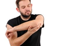 Man with pain in elbow. Arm pain. Man with pain in elbow royalty free stock images