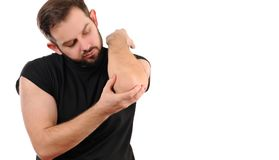 Man with pain in elbow. Arm pain. Man with pain in elbow royalty free stock photos