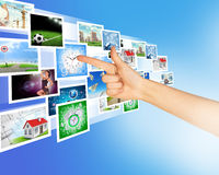 Arm pointing at holographic pictures Stock Photography