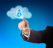 Arm Pointing At Knowledge Worker In Cloud Icon. Arm in dark blue business suit reaching out to point at a knowledge worker icon inside a floating cloud computing Stock Photos
