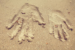 Arm print on sand Stock Image