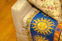 Arm rest yellow sofa Stock Photo