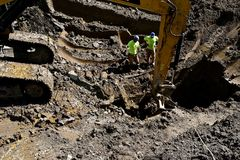 Excavating a huge hole stock photography
