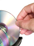 Arm selecting optical disc from data storage. Hand choosing optical disc from computer data storage isolated on white Stock Photos