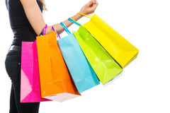 Arm with shopping bags. On white background stock image