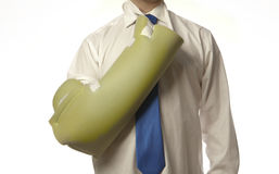 Arm in a sling. Man useing a cory sling Royalty Free Stock Photography