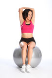 Arm stretch exercise by beautiful woman in gym Royalty Free Stock Photography