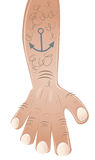 Arm with tattoo anchor Royalty Free Stock Images