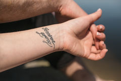 Arm with tattoo Royalty Free Stock Photos
