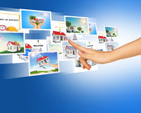Arm touching blue holographic pictures Royalty Free Stock Images