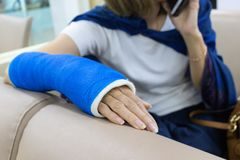 Arm of woman who have got wounded and wearing a splint. That wrapped around with blue cloth in the hospital, Woman got accident royalty free stock photos