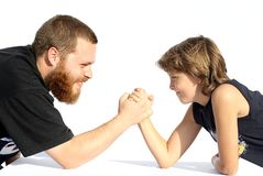 Arm wrestling. Father and son arm wrestling Stock Images