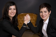 Two Attractive Business Women Arm Wrestling Royalty Free Stock Photo