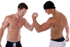 Arm wrestling. Two men arm wrestling. Taken against a white background Royalty Free Stock Photography