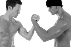 Arm wrestling. Two men arm wrestling. Taken in black and white Royalty Free Stock Images