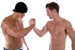 Arm wrestling. Two men arm wrestling. Taken against a white background Stock Photo