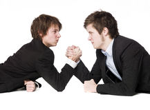 Arm wrestling. Two men Arm wrestling towards white background Stock Photography