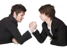 Arm wrestling. Two men Arm wrestling towards white background Royalty Free Stock Photos
