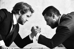 Arm wrestling of businessman and compete man. Co workers and dominance Stock Photo
