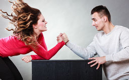 Arm wrestling challenge between young couple Stock Photography