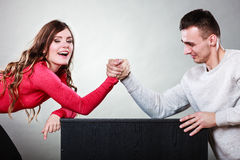 Arm wrestling challenge between young couple Royalty Free Stock Images