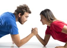 Arm wrestling between a couple Stock Images