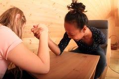Arm wrestling - fighting girls stock image