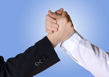 Arm wrestling/hands symbolizing team/competition. Two business hands in a rivalry position, can also be seen as handshake or handclasp symbolizing teamwork Royalty Free Stock Photos