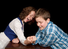 Arm-wrestling teenagers Stock Images