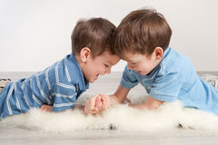 Arm wrestling and two brothers Royalty Free Stock Photography