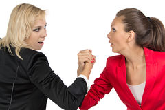 Arm wrestling of two smiling businesswoman Stock Images
