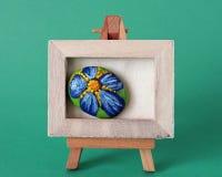 Armação com flor pintada fotos de stock