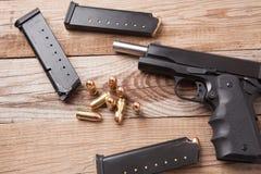 Arma con las balas Foto de archivo libre de regalías