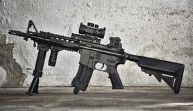 Arma da espingarda de assalto, armas M4A1 e equipamento militar para o exército Fotos de Stock Royalty Free