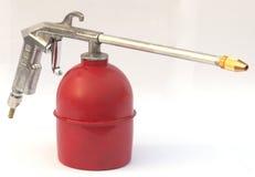 Arma de aerosol de gasolina y aceite Foto de archivo libre de regalías