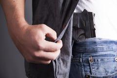 Arma de fuego que revela Fotos de archivo