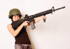 Arma de la explotación agrícola de la muchacha Imagenes de archivo