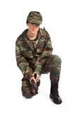 Arma de la explotación agrícola de la muchacha del ejército Imagen de archivo libre de regalías