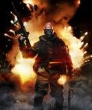 Arma de Man Hold Machine del soldado en el fondo de la explosión Foto de archivo