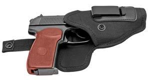 Arma de mano en una pistolera Fotos de archivo libres de regalías
