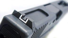 Arma de mano trasera de la vista del hierro aislada en el fondo blanco Imágenes de archivo libres de regalías