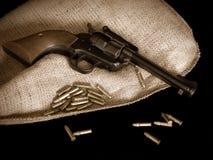 Arma de mano y puntos negros Fotos de archivo