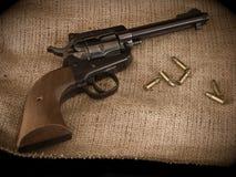 Arma de mano y puntos negros Imagen de archivo