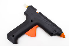 Arma de pegamento caliente negro fotografía de archivo